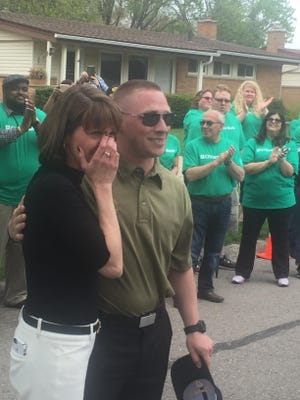 Retired U.S. Army Staff Sgt. John Blizinski and his wife, Nicole, get their first look at the home on Delaware.