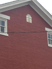 """A placard on this house reads """"Built by J. Grove and Wife, 1861."""""""