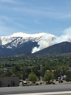 Smoke is seen from a prescribed burn near Mt. Rose.