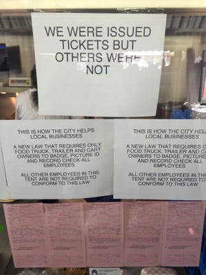 Tickets issued by the City of Rochester are on display May 11, 2016 at Nick Tahou's station at the Lilac Festival.