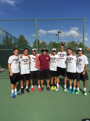Scottsdale Desert Mountain boys tennis coach Dan LeFevre, middle, with his team.