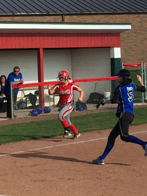 Emma Vidal races for the plate to score a run Friday for Oak Harbor.