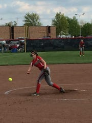 Oak Harbor's Emma Bergman throws a pitch Friday.