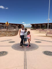 Lorena, Robbie and Madeline Wade stop at the Four Corners, where Colorado, Utah, New Mexico and Arizona come together.