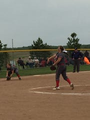 Bellevue's Lyndsey Seamon throws a pitch Friday against Clyde with Jena Weider set on defense.