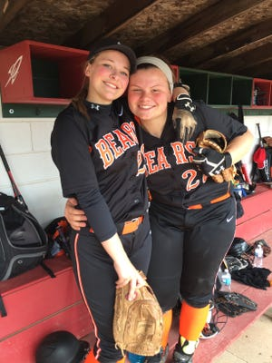 First-cousins Libby Henderson, left, and Abby Cantrell hit home runs Saturday in Gibsonburg's win over Lakota.