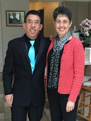 Sam Goto, with his mother Stacy Goto.