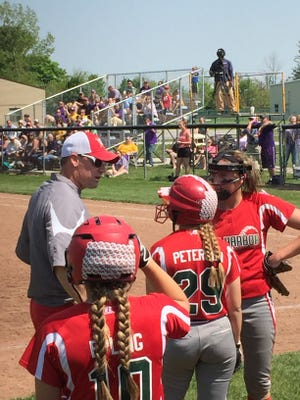 Oak Harbor coach Chris Rawski talks Sunday to Seree Petersen, middle, and Ashley Riley, right. Dani Epling looks on.