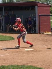 Oak Harbor's Olivia Rollins squares at the plate in the postseason.