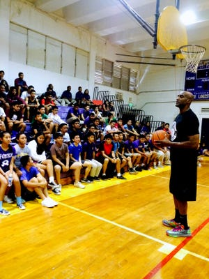 Trainer Jonathan Triplett goes over an important part of the camp as he covers Life Skills with the students of George Washington High School during 1st Class Guam Basketball's Clinic on May 6.