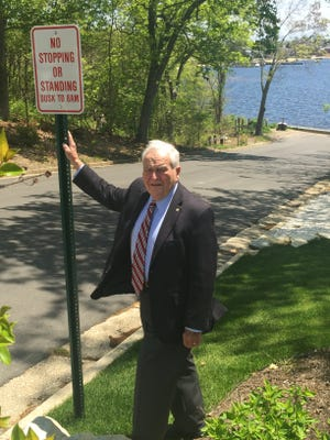 Toms River Mayor Thomas F. Kelaher stands next to a no parking sign the township has installed on Cedar Drive next to Brown's Woods park.