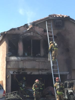 A fire ripped through a two-story home in Peoria around 9 a.m. on May 24, 2016.