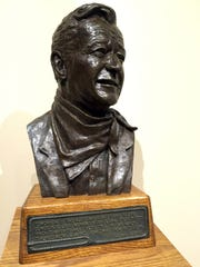 A bust of John Wayne greets visitors just inside the door to the gallery in the museum dedicated to the famous native son in downtown Winterset.