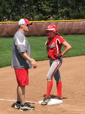 Oak Harbor's Ashley Riley talks with coach Chris Rawski at third base. Riley was recognized first-team all-Sandusky Bay Conference.