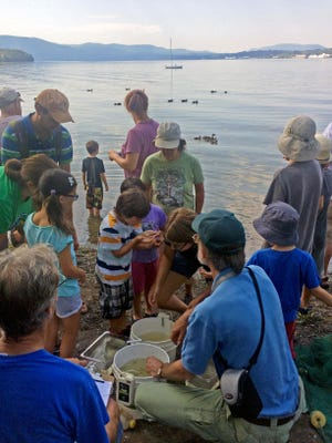 Children are shown how to enjoy being outside by experiencing nature and learning about the natural world at Scenic Hudson's Long Dock Park.