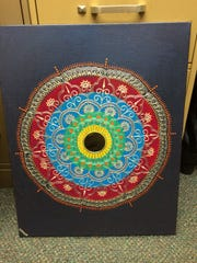 One of six paintings recovered by the East Lansing Police Department after being stolen during the 2016 East Lansing Art Festival.