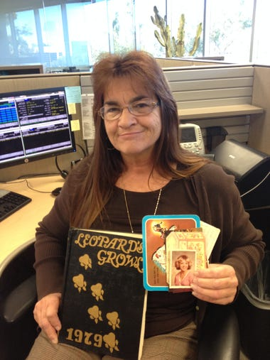Laurel Nowell, with a photo of Tammy Jo Alexander and