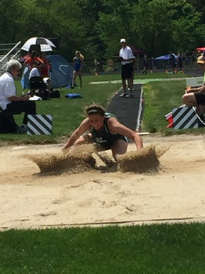 Oak Harbor's Emma Barney lands 17 feet 7 inches from where she left the track to finish fourth in the long jump Saturday and qualify to state.