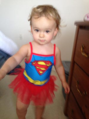 Despite the photo being a little blurry, Isabella looks adorable in her new Supergirl swim suit. Getting a non-blurry photo continues to be a challenge.