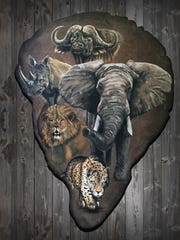 An elephant ear with Africa's Big Five painted on it by Eric Peterson.