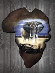A completed painting by Eric Peterson on an elephant