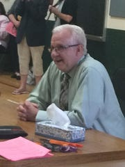 Michael Fraley listens during a surprise retirement party at Sullivan Elementary School.
