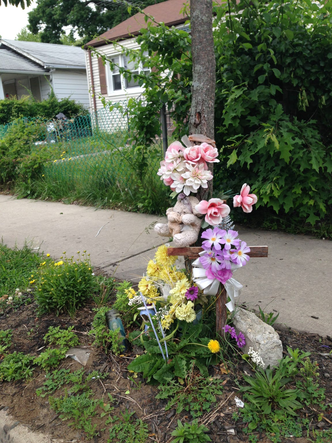 A curbside memorial marks the site where Tamara Wilson-Seidle
