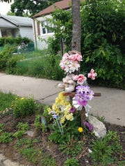 A curbside memorial marks the site where Tamara Wilson-Seidle was gunned down by her ex-husband, Philip Seidle, on Sewell Avenue in Asbury Park.