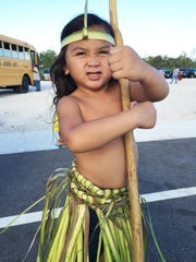 "Kenny-Kage Tereas Susuico, 4, shows his ""Hulk face"" following the performance of his uncles and fellow countrymen who are all descendants of people from the Mortlock Island of Ettal, some 250 kilometers southeast of the Chuuk capital."