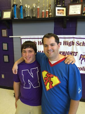 Brandon Netto, left, and his band teacher, Steve Sigmon, at North Henderson High on Friday. Sigmon and Netto say band was like a second family to Netto, who lost his mother May 18 after a brief battle with lung cancer.