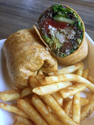 Viva Chicken's Naked Peruvian is a sun dried tomato wrap filled with organic quinoa, a kale romaine mix, cucumber, tomato, queso fresco, rocoto mayo, avocado and for a couple bucks extra, pulled rotisseries chicken.