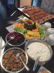 Granola, yogurt, fruit and pastries are among the choices at the Char brunch buffet.