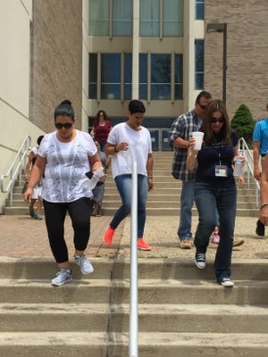 """At noon Friday, Vineland employees took a group walk on their lunch hour to participate in a new wellness program, """"Wear Your Sneakers to Work"""" day."""