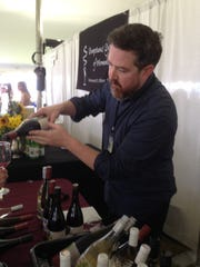 Thomas Sichta, sales manager at Chehalem, a winery in Oregon, pours a sample Saturday at the Burlington Wine and Food Festival.