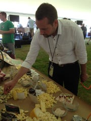 Jonathan Bosman of Burgundy, France, samples cheese Saturday at the Burlington Wine and Food Festival.