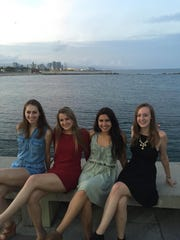 Emily Durfee (left to right), Shannon Boyle, Cassidy DeStefano and Katie Downing enjoyed a farewell seafood dinner with their group on the Barcelona waterfront.