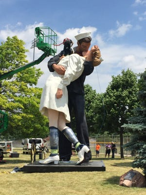 A 25-foot-tall statue of the famous photo depicting a sailor kissing a nurse in New York's Times Square on V-J Day has been erected at 13 Mile and Woodward in Royal Oak as part of a publicity and fundraising effort by the Michigan World War II Legacy Memorial.