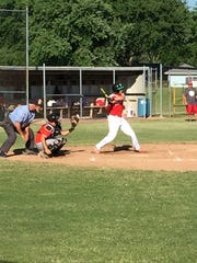 Sandusky American Legion Post 83's James Fisher puts and infield single in play Tuesday.