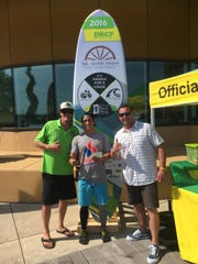Dean Randazzo Cancer Foundation Ambassador Richard Nugent of Margate and past president and race director Paul Giunta of Somers Point award Quintin Chiapperino, 19, of Saint Croix, U.S. Virgin Islands, with a $1,000 check for his win in the 22.5-mile Paddle For A Cause presented by J&L Amish Depot.