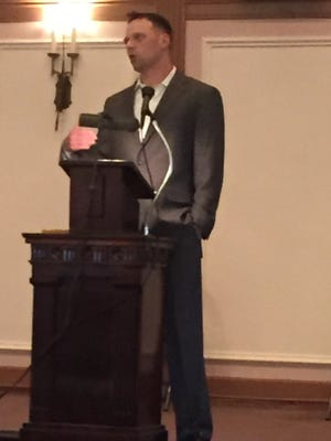 New England Patriots assistant coach Josh Boyer, a Heath graduate, addresses the Licking County and Muskingum Valley all-stars Thursday during the banquet at the Newark Downtown Elks.
