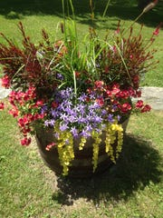 Flowers in a barrel are part of the gardens made by Carol Charles at Inn at the Round Barn in Waitsfield.
