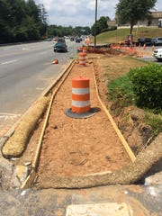 The sidewalk project along Hendersonville Road will