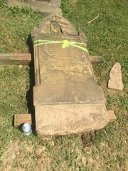 This large sandstone marker required resetting because it was too heavy for its base's collar.