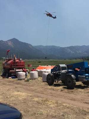Helicopters, airplanes and other heavy equipment are being used to fight the Saddle Fire near Pine Valley, Utah.
