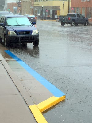 A thunderstorm brought some rain to downtown Silver City on Monday afternoon.