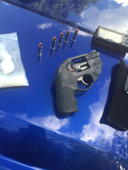 636027404407346896-0628-guns-and-drugs-in-traffic-stop.JPG