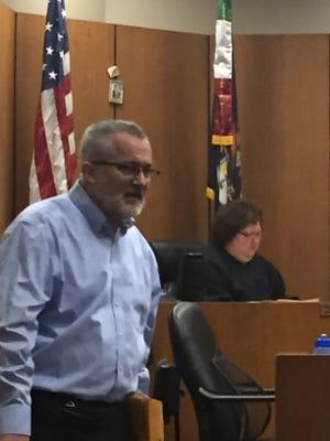 Rev. Timothy Kane in the courtroom of Judge Margaret Van Houten in Wayne County Circuit Court.