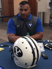 BYU head football coach Kalani Sitake talks with members of the media during the Cougars' sixth  annual Football Media Day on Thursday.