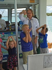 Glen Beitmen makes sure the kids on the cruise enjoy the day on the water.