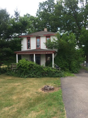 This house at 615 S. Michigan Ave. in Howell, just north of the railroad tracks, has been marked for demolition.